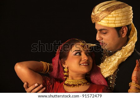wedding photo shoot on black ground / bride and groom - stock photo