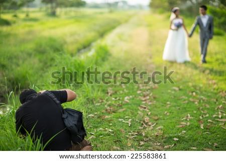 wedding photographer in action - stock photo