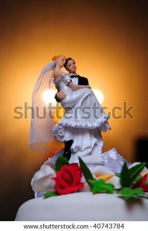 Wedding pie with figures of groom and bride - stock photo