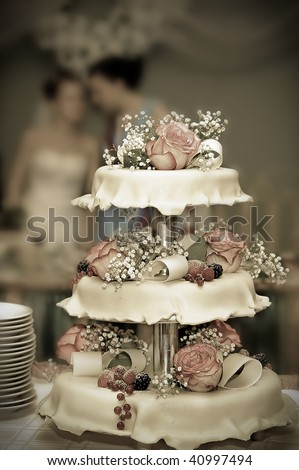 Wedding pie with roses and berries - stock photo