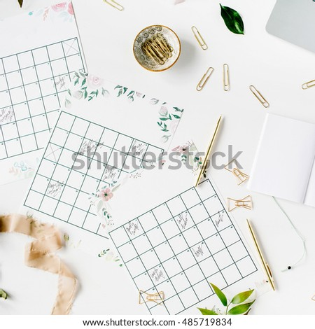 wedding planner schedule calendar painted with watercolor laptop notebook and accessories flat lay