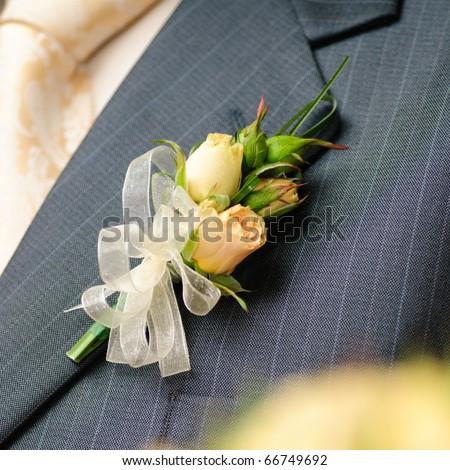 Wedding posy on the lapel of groom's jacket - stock photo
