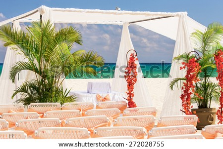 Wedding preparation on Mexican beach against beautiful sea background - stock photo