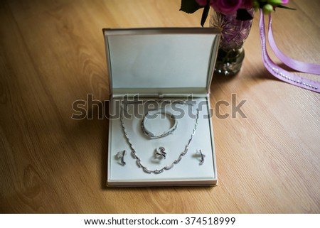 wedding preparation, pendant, chain and earrings for women, wedding jewelry  - stock photo