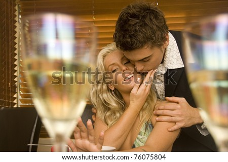 Wedding proposal at a restaurant - stock photo