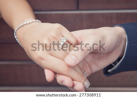 wedding proposal with diamond ring - stock photo