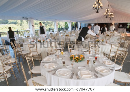 Wedding reception area ready for dinner and the party - stock photo