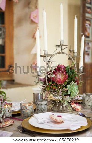 Wedding reception decor details, flowers and table centerpiece with white candles