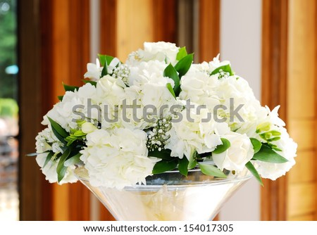 Wedding reception floral arrangement, closeup detail of white flowers - stock photo