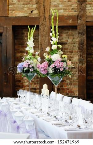 Wedding reception flower arrangement with pink and white decoration on table - stock photo
