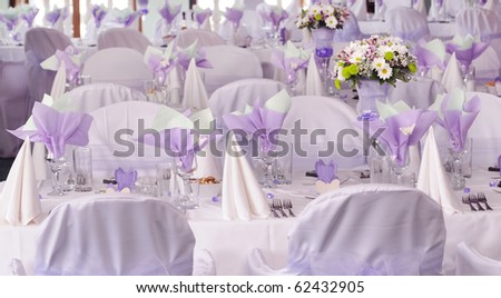 Wedding reception place ready for guests. violet color style accent