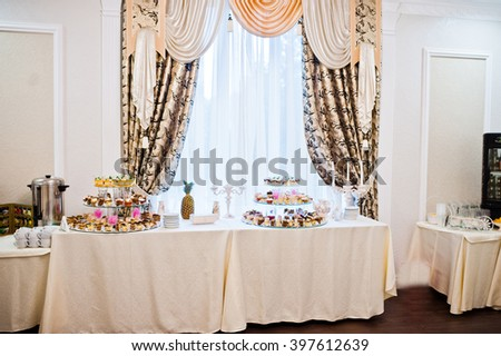 Wedding reception, table of cakes and sweet