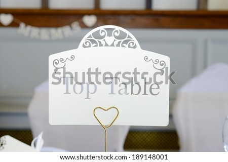 Wedding reception top table closeup decoration - stock photo