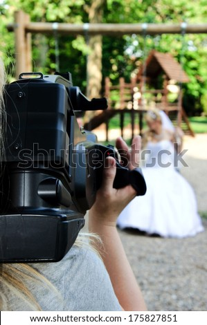 Wedding recording with the camera.Selective focus on the camera  - stock photo