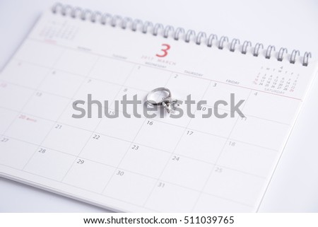 wedding ring and calendar