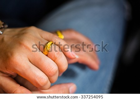 Wedding ring ,couple people touch hands for good feeling.