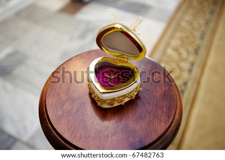Wedding ring for newlyweds on luxury decor casket