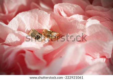 wedding ring in flowers background - stock photo