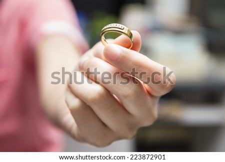 Wedding ring in hand