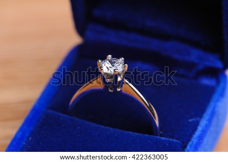 wedding ring in the box on wooden table