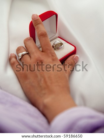Wedding ring on bride hands