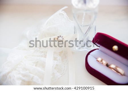 Wedding ring on the bride's wedding garter and spirits