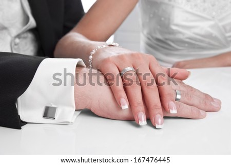 Wedding ring with stone on bride hand - marriage - stock photo