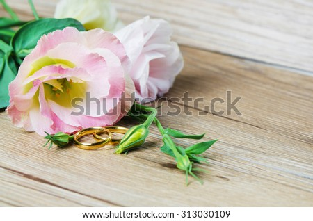 Wedding rings and Eustoma flower/Wedding rings/Wedding rings - stock photo
