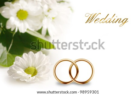 Wedding rings and flowers composition - stock photo