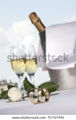 Wedding rings and glasses of champagne
