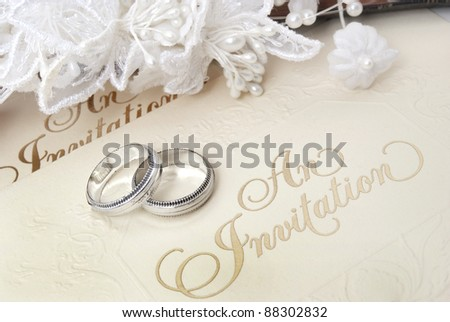 wedding rings and invite - stock photo