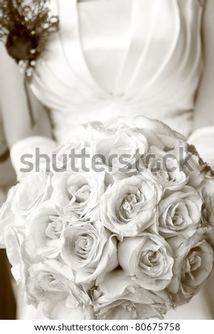 Wedding rings and pink rose bouquet - stock photo