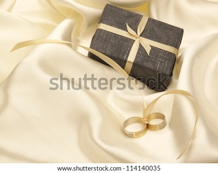 Wedding rings and present box - stock photo
