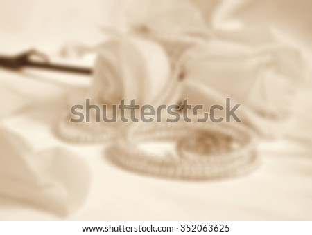 Wedding rings and roses in blur style can use as wedding background. In Sepia toned. Retro style