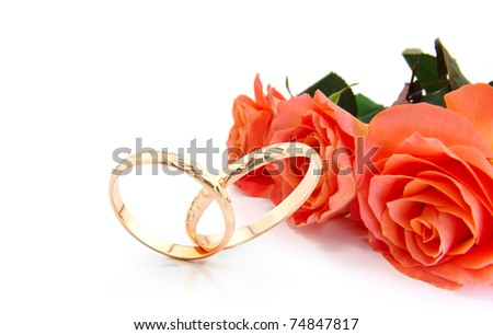 wedding rings and roses on white with space for writing (wedding invitation card ) - stock photo