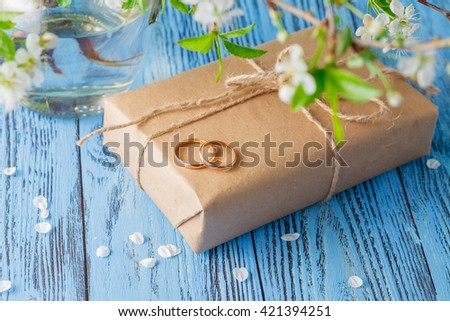 Wedding rings and spring flowers - stock photo