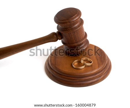 Wedding rings and wooden gavel on a white background - stock photo