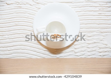 wedding rings in a circle, which is hanging on the wall - stock photo