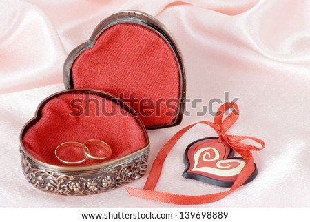Wedding rings in a metal box with decorative ornament