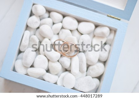 Wedding rings in blue box with white stone.Wedding ceremony