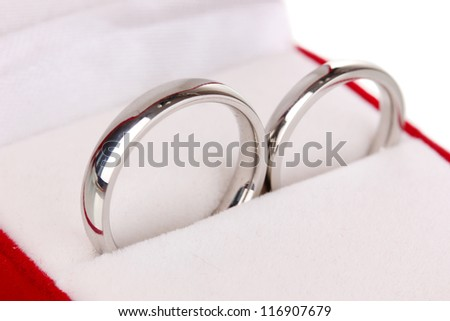 Wedding rings in red box close-up - stock photo