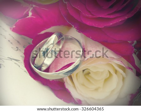 wedding rings in retro arrangement - stock photo