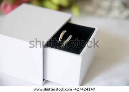 Wedding rings in white box with black velvet - stock photo