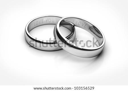 wedding rings isolated on white background - stock photo