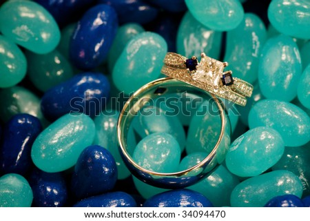 wedding rings laying in a jar of jelly beans
