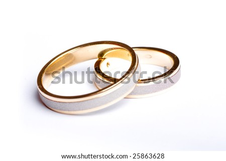 Wedding rings laying together.