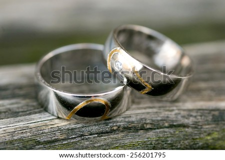 wedding rings on a bench