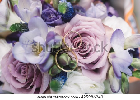 Wedding rings on a bouquet  - stock photo