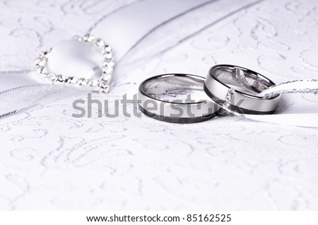 wedding rings on a pillow - stock photo