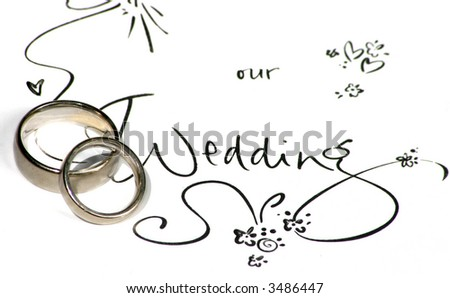 """wedding rings on a sign saying """"our wedding"""" - stock photo"""
